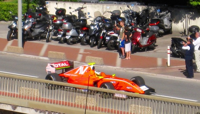 Formula 1 race car driving down Princess Grace Avenue, Monte Carlo.
